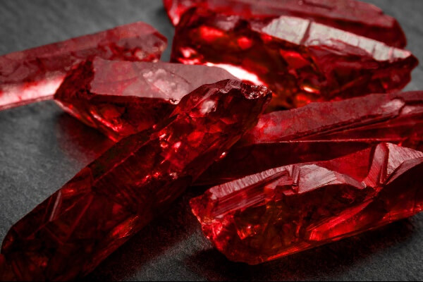 Seven Ruby crystals on a table