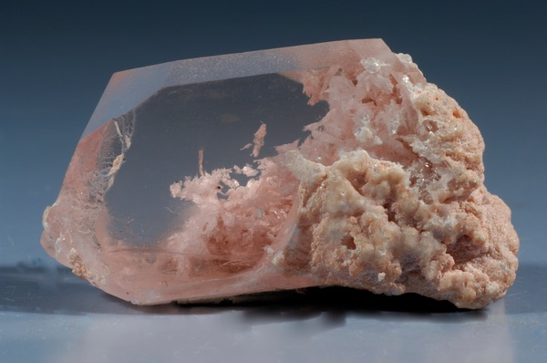 A raw and partially clear piece of Morganite