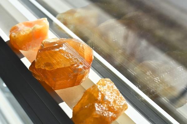 Three Honey Calcite stones in the sun