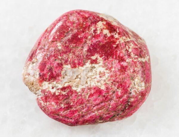 A rough Thulite stone