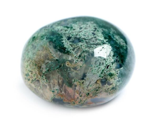 A round polished piece of Moss Agate