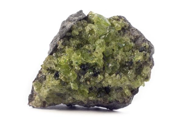 Raw Peridot within a piece of rock