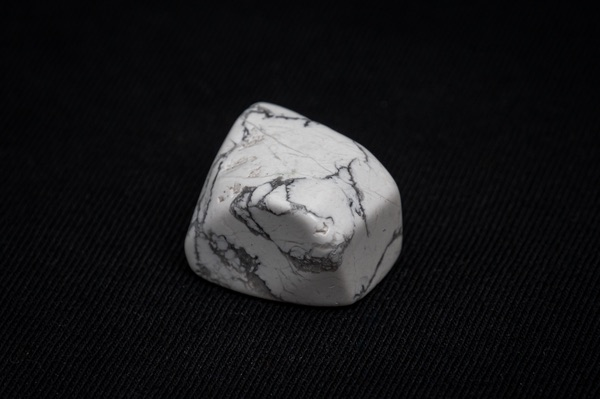 Howlite stone on a black background
