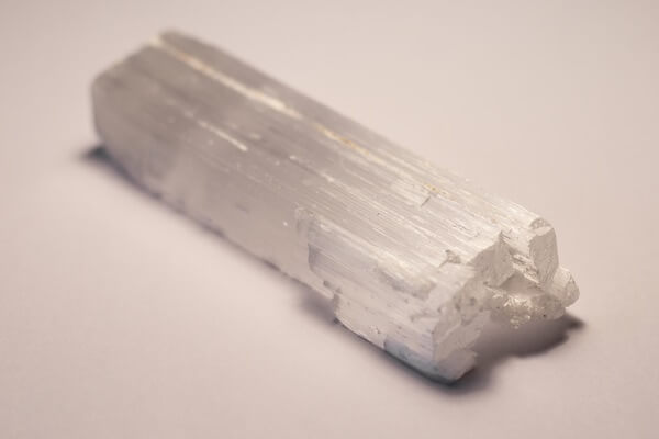 White and thin piece of Selenite