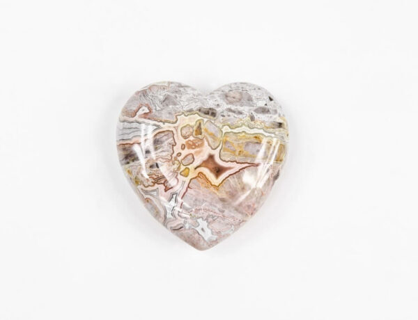 A heart shaped piece of Crazy Lace Agate