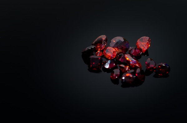 Multiple Ruby Leo gemstones on a black background