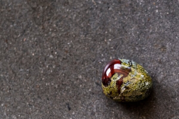 Dragon Blood Jasper on the ground being used for healing practice