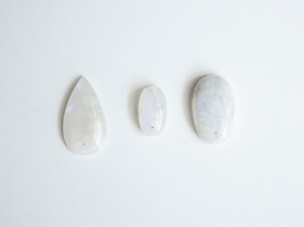Polished and tumbled Rainbow Moonstones being used for healing